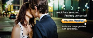 Paypal necklace ad: Girl kissing man under city lights.