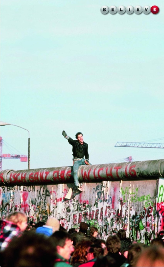 Powerball Lottery ad: A man straddles the Berlin Wall in 1989.