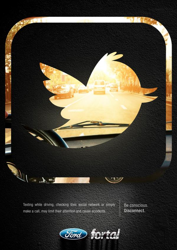 Disconnect ad: Driving with Twitter logo on windshield.