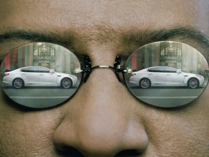 Kia Matrix commercial: K900 reflected in Morpheus' glasses.