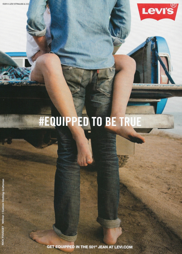 Levis ad: Denim-clad guy makes out with girl on pickup truck.