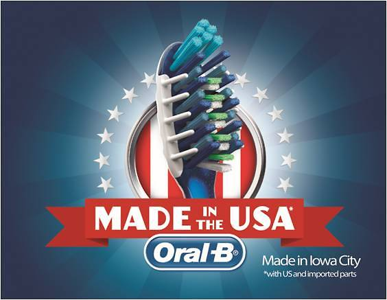 Oral-B toothbrush amid stars and stripes: Made in the USA.