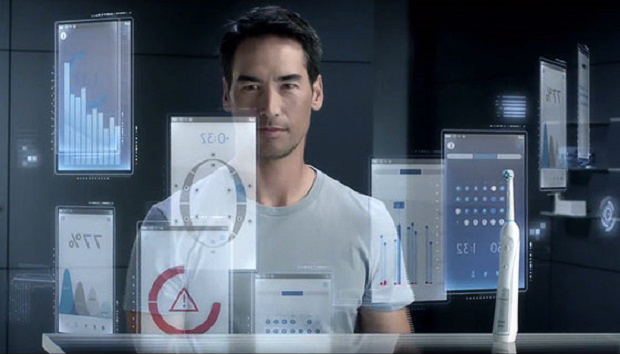 Man organizes toothbrushing data on a transparent screen in his bathroom.