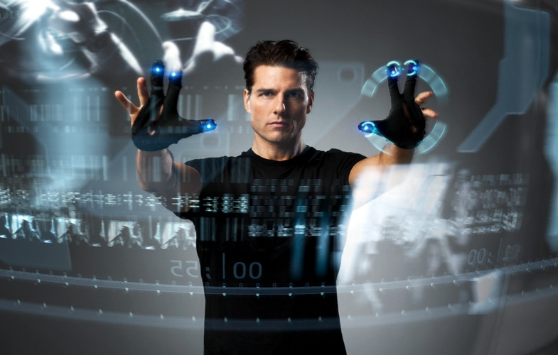 Tom Cruise operates transparent touchscreen in Minority Report.