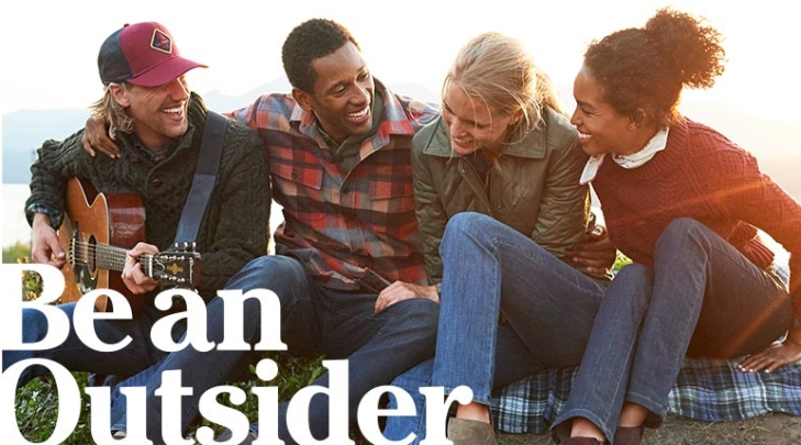 """LL Bean """"Be an Outsider"""" ad: Friends seated on a blanket outdoors smile as one plays guitar."""