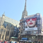 Coco Chanel billboard of a woman's face across from St. Stephen's Cathedral in Vienna.