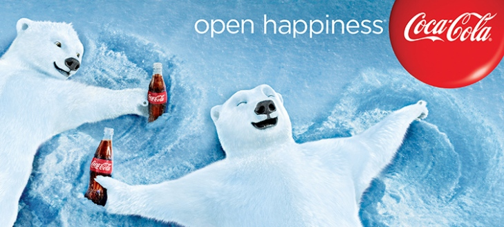 """Coca-Cola """"Open Happiness"""" billboard from 2013: Polar bears make snow angels with a bottle of Coke in hand."""
