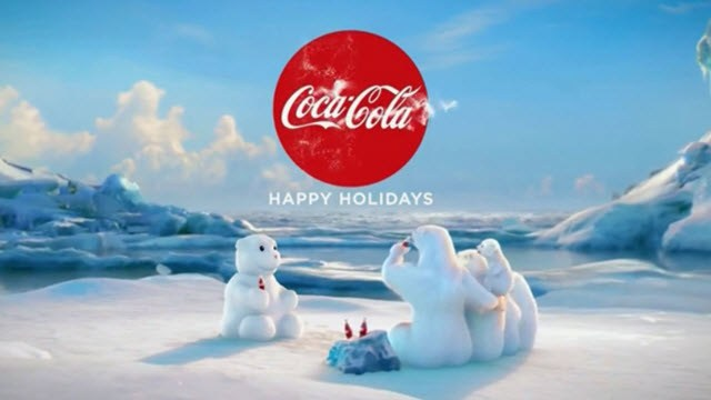 """Coca-Cola """"Happy Holidays"""" commercial (end frame): Polar bears drink Coke with a snowman."""