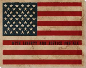 "A vintage American Flag and the text ""with liberty and justice for all."""